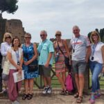 A happy small group visiting the Roman Forum