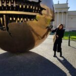 Francesca and the sphere of Pomodoro in the courtyard of Vatican Museums