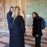 Francesca explaining the map of Rome in the Gallery of Maps