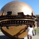 The sphere of the artist Pomodoro in the courtyard of Vatican Museums