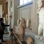 Tourist guide at work Musei Vaticani inside